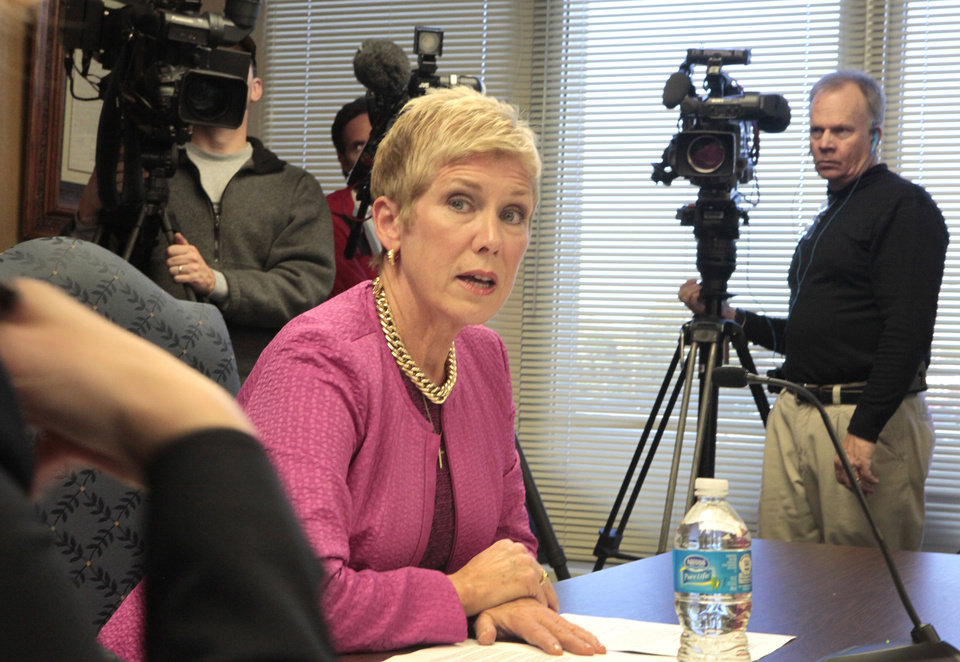 Photo - State schools Superintendent Janet Barresi is seen Tuesday at the Board of Education special meeting to certify and release A-F report cards for schools. Photo by David McDaniel, The Oklahoman  David McDaniel