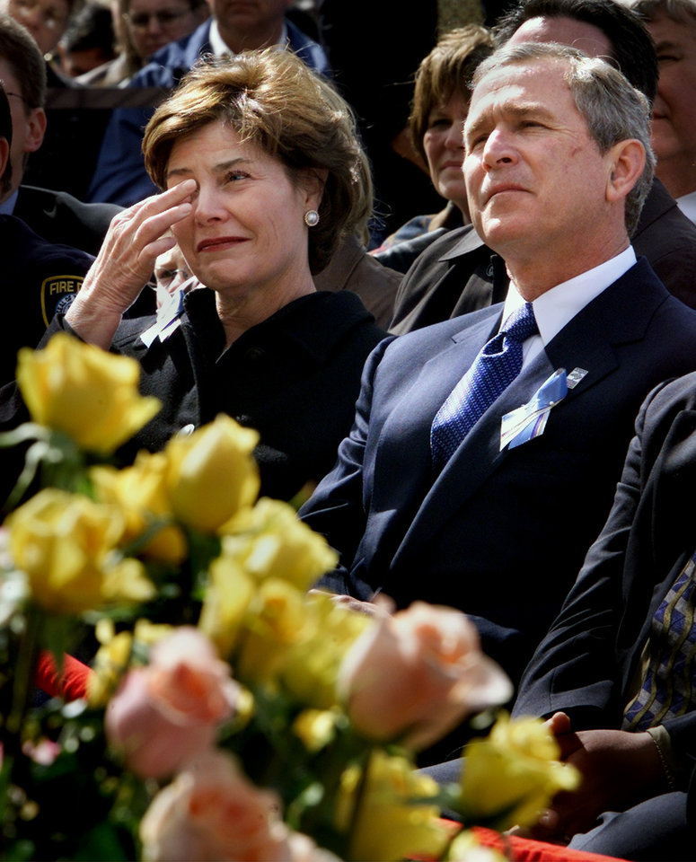 Photo - Former President George W. Bush and Former First Lady Laura Bush attend an emotional and solemn ceremony for the dedication of the museum at the Oklahoma City National Memorial Center on Feb. 19, 2001. (AP Photo/J. Scott Applewhite)