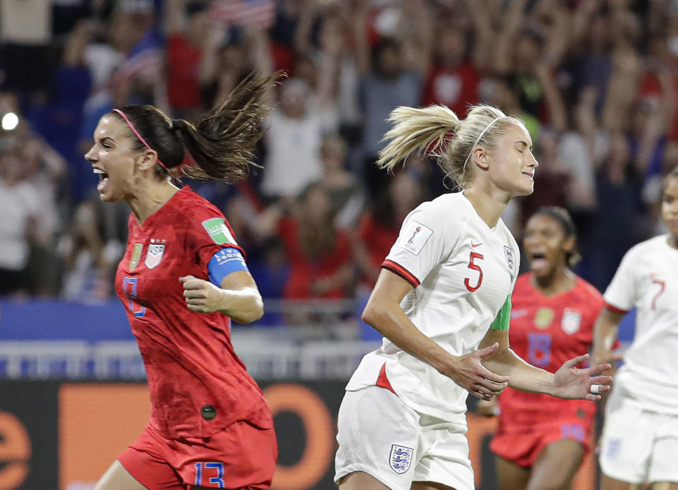 Photo - England's Steph Houghton, right, grimaces after failing to score from the penalty spot as United States' Alex Morgan celebrates during the Women's World Cup semifinal soccer match between England and the United States, at the Stade de Lyon, outside Lyon, France, Tuesday, July 2, 2019. (AP Photo/Alessandra Tarantino)