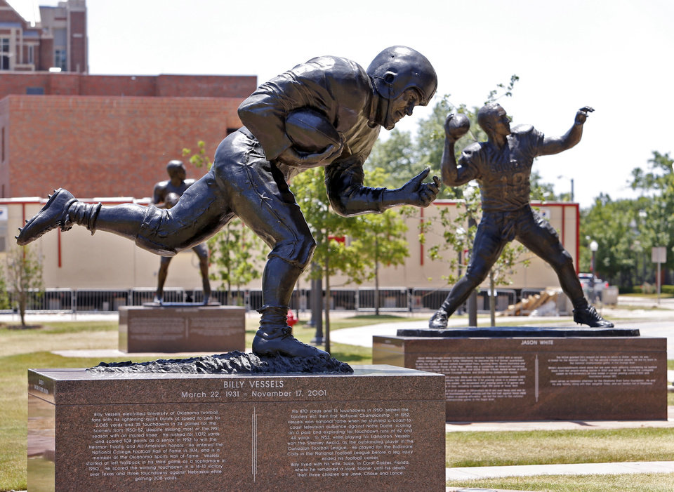 Photo -  The statue of Billy Vessels in Heisman Park across from the Oklahoma Memorial Stadium has progressively bent forward and to the side and appears to be sinking, as seen June 11, 2015, in Norman. [Steve Sisney/The Oklahoman archives]
