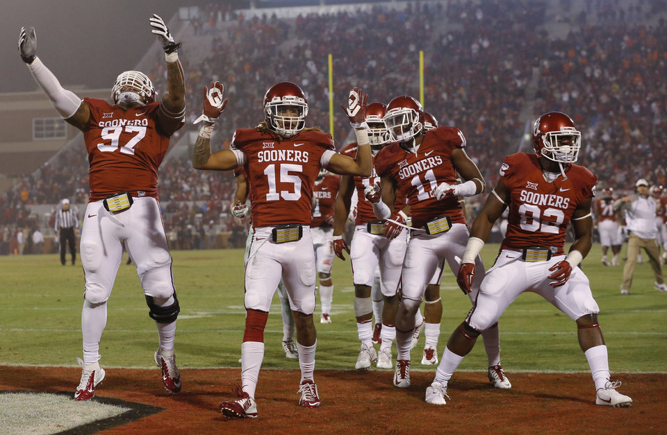 Photo - Oklahoma's Zack Sanchez (15) celebrates after an interception beside Charles Walker (97), Steven Parker (11), and Ogbonnia Okoronkwo (82) during a Bedlam college football game between the University of Oklahoma Sooners (OU) and the Oklahoma State Cowboys (OSU) at Gaylord Family-Oklahoma Memorial Stadium in Norman, Okla., Saturday, Dec. 6, 2014. Photo by Bryan Terry, The Oklahoman