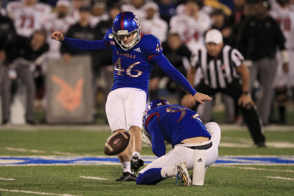 Photo - Kansas place kicker Liam Jones (46) kicks a game-winning field goal from the hold of Donovan Gagen (92) during the second half of an NCAA college football game against Texas Tech in Lawrence, Kan., Saturday, Oct. 26, 2019. Kansas defeated Texas Tech 37-34. (AP Photo/Orlin Wagner)