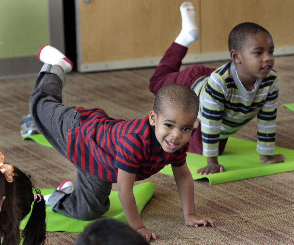 Photo - Brayden Swain and Kingston Mosby attend a class as Angela Moorad teaches yoga to three and four-year-olds on Wednesday, March 7, 2012, in Oklahoma City, Okla.  Photo by Steve Sisney, The Oklahoman