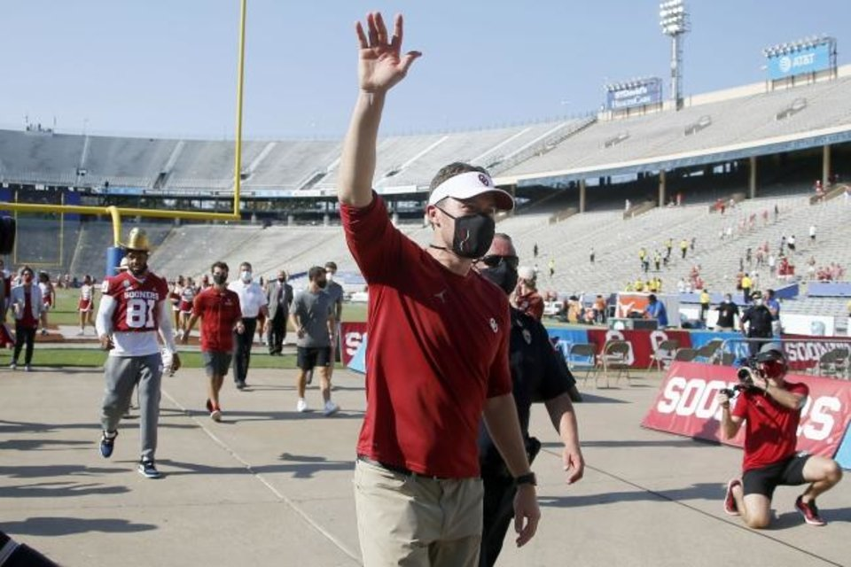 Photo -  Oklahoma coach Lincoln Riley waves to fans he leaves the field following the Red River Showdown win over Texas on Oct. 10 in Dallas. [Bryan Terry/The Oklahoman]