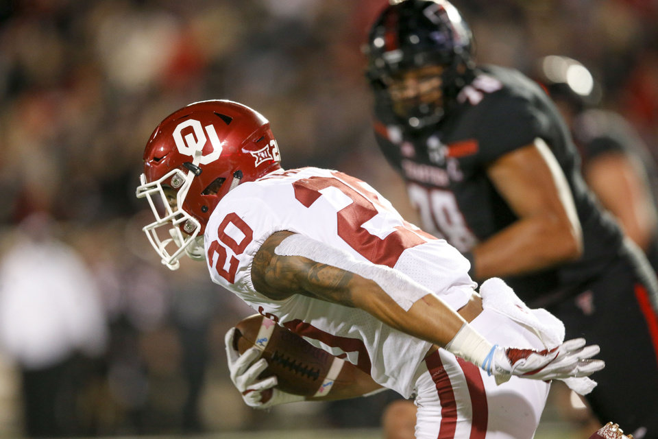 Photo - Oklahoma Sooners safety Robert Barnes (20) intercepts a attempted two pain conversion during the NCAA football game between the Texas Tech Red Raiders and the Oklahoma Sooners at Jones AT&T Stadium in Lubbock, Texas on Saturday, November 03, 2018. IAN MAULE/Tulsa World