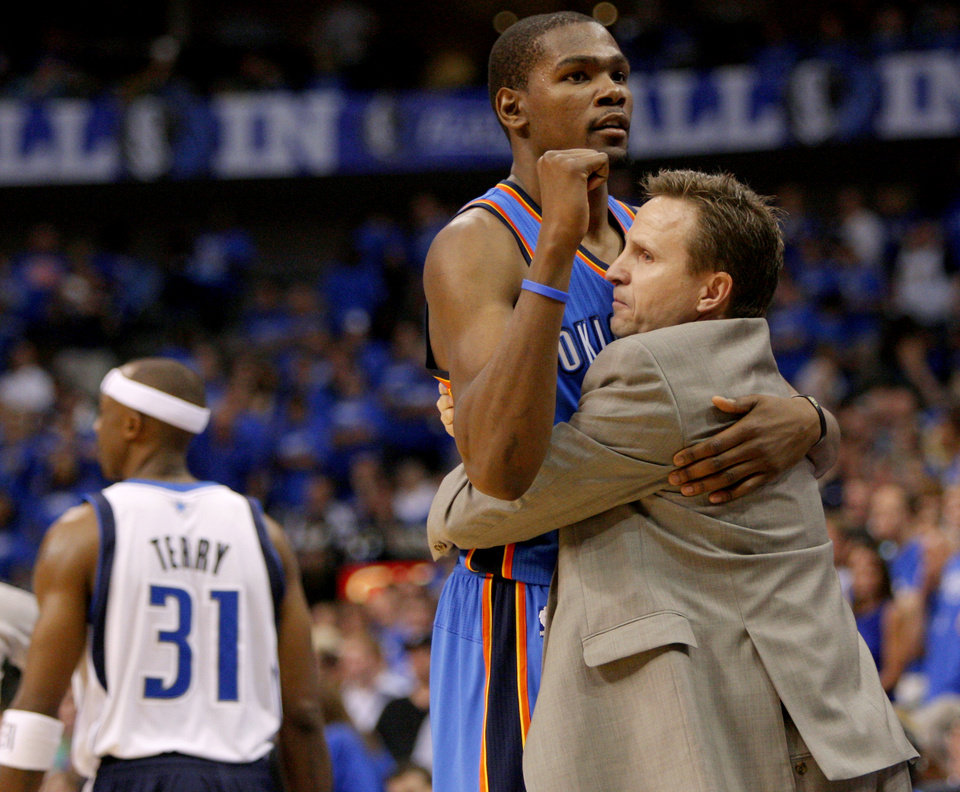 Photo - Oklahoma City's Kevin Durant (35) celebrates with coach Scott Brooks beside Dallas' Jason Terry (31) during Game 4 of the first round in the NBA playoffs between the Oklahoma City Thunder and the Dallas Mavericks at American Airlines Center in Dallas, Saturday, May 5, 2012. Oklahoma City won 103-97. Photo by Bryan Terry, The Oklahoman