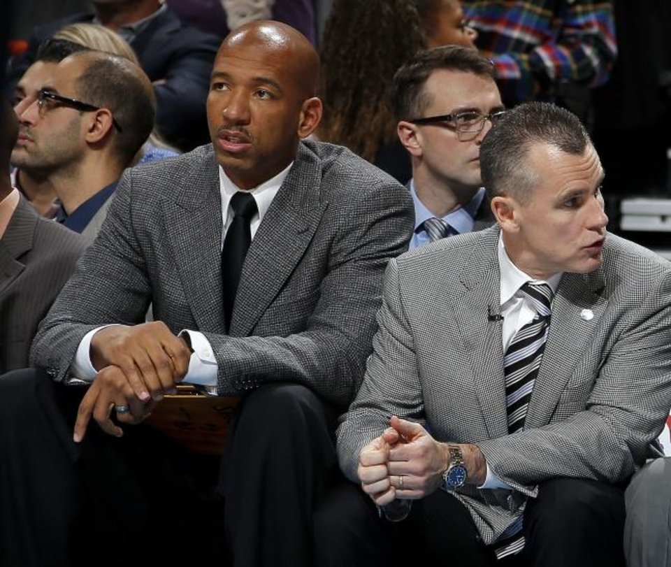Photo -  Former Thunder assistant coach Monty Williams, seen sitting by head coach Billy Donovan in 2015, is heading into his first season as head coach of the Phoenix Suns. [Bryan Terry/The Oklahoman]