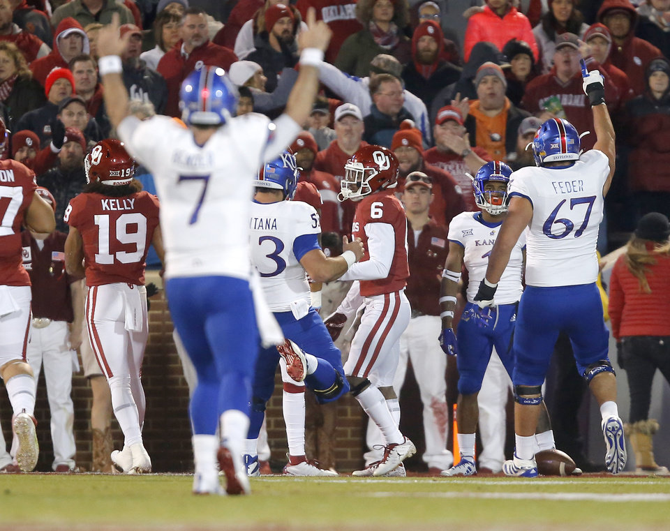Photo - Kansas' Pooka Williams Jr. (1) celebrates a touchdown beside Oklahoma's Tre Brown (6) during a college football game between the University of Oklahoma Sooners (OU) and the Kansas Jayhawks (KU) at Gaylord Family-Oklahoma Memorial Stadium in Norman, Okla., Saturday, Nov. 17, 2018. Photo by Bryan Terry, The Oklahoman