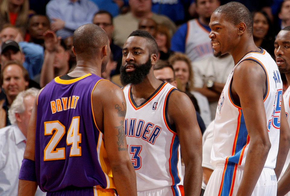 Photo - Oklahoma City's James Harden (13) and Kevin Durant (35) reacts next to Los Angeles' Kobe Bryant (24) during an NBA basketball game between the Oklahoma City Thunder and the Los Angeles Lakers at Chesapeake Energy Arena in Oklahoma City, Thursday, Feb. 23, 2012. Oklahoma City won 100-85. Photo by Bryan Terry, The Oklahoman