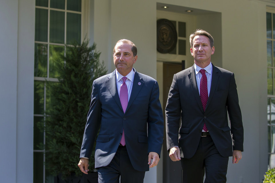 Photo -  Health and Human Services Secretary Alex Azar, left, and acting FDA Commissioner Ned Sharpless arrive to speak with reporters after a meeting about vaping with President Donald Trump in the Oval Office of the White House, Wednesday, Sept. 11, 2019, in Washington. (AP Photo/Alex Brandon)