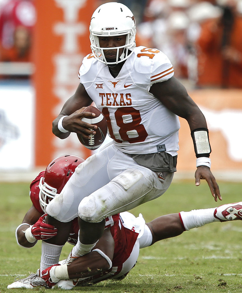 Photo - Oklahoma's Eric Striker (19) gets a sack on Texas' Tyrone Swoopes (18) during the college football game between the University of Oklahoma Sooners (OU) and the University of Texas Longhorns (UT) during the Red River Showdown at the Cotton bowl in Dallas, Texas on Saturday, Oct. 11, 2014. Photo by Chris Landsberger, The Oklahoman