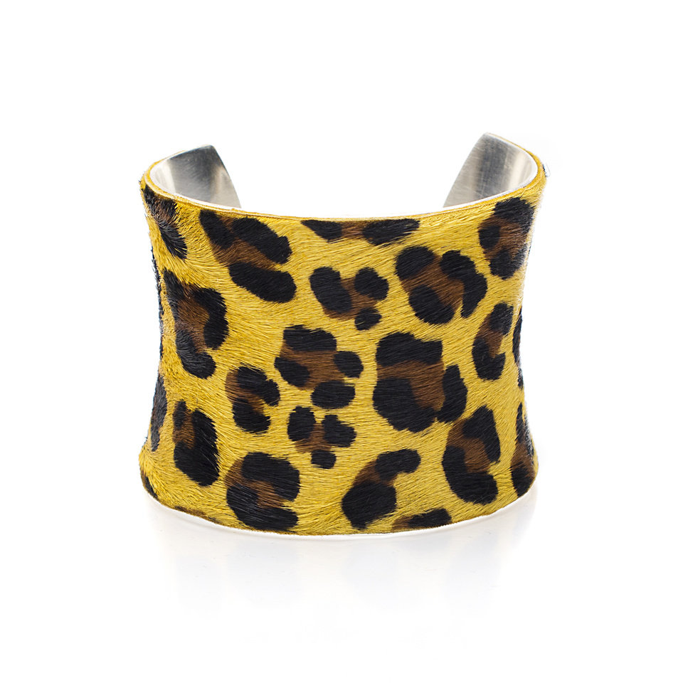 Photo -  Rustic Cuff yellow calfskin leopard print cuff, available at Rustic Cuff stores in Edmond and Classen Curve. [Photo provided]
