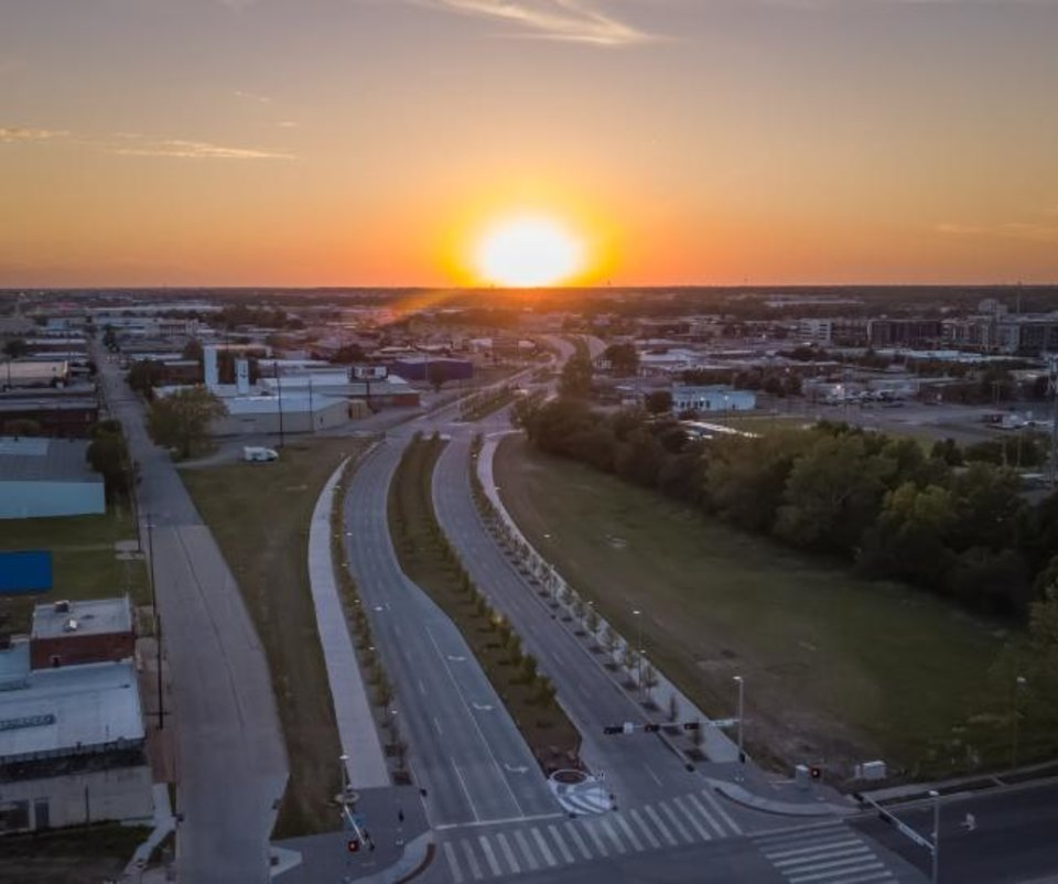 Photo -  The sun sets over a desolate Oklahoma City Boulevard opened last  year as part of a rapid transformation of the metro that has been slowed but not stopped by the COVID-19 pandemic. [DAVE MORRIS/THE OKLAHOMAN]