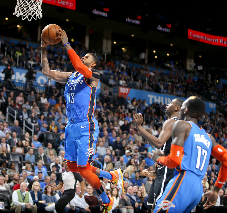 Photo - Oklahoma City's Paul George (13) goes to the basket during an NBA basketball game between the Oklahoma City Thunder and the Brooklyn Nets at Chesapeake Energy Arena in Oklahoma City, Wednesday, March 13, 2019. Oklahoma City won 108-96. Photo by Bryan Terry, The Oklahoman
