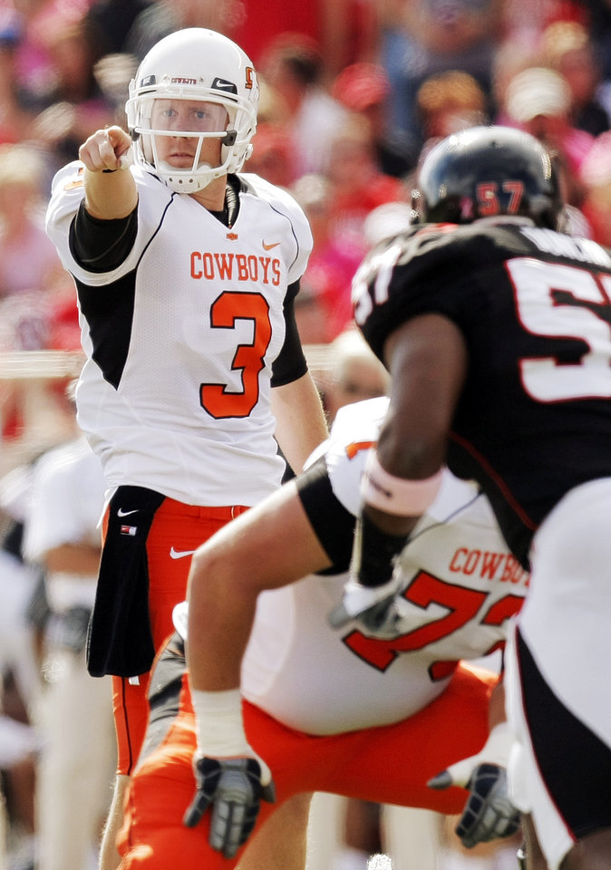 Photo - OSU quarterback Brandon Weeden (3) points before a play during the college football game between the Oklahoma State University Cowboys and Texas Tech University Red Raiders at Jones AT&T Stadium in Lubbock, Texas, Saturday, October 16, 2010. Photo by Nate Billings, The Oklahoman