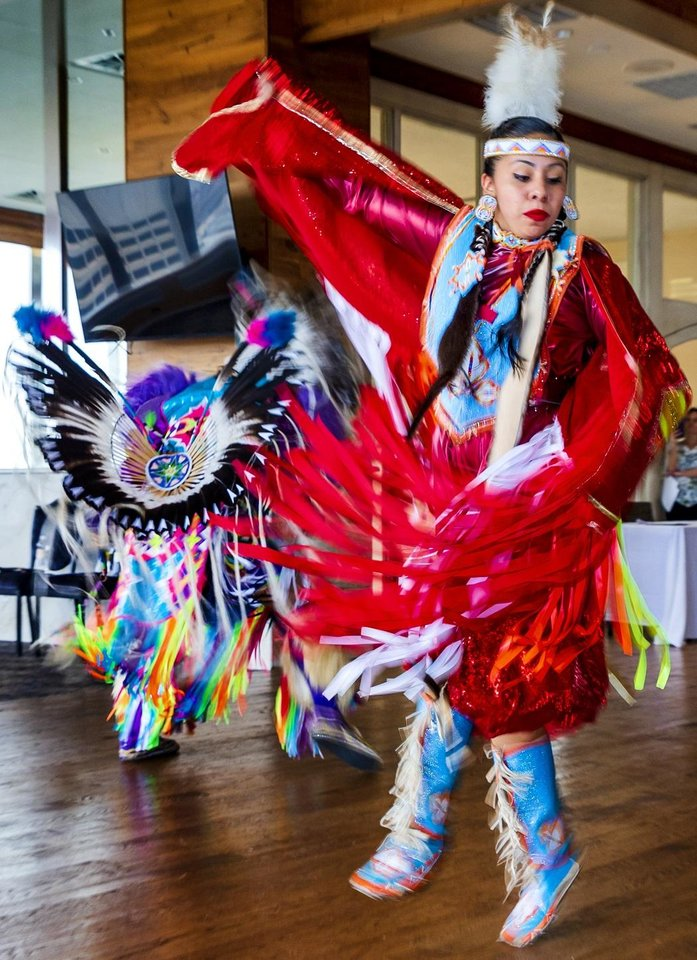 Photo - Native American dancers Courtney Reeder and Cecil Gray perform during a Red Earth press conference at the Petroleum Club in Oklahoma City, Okla. on Monday, Feb. 17, 2020. The news conference announced a new location for the annual Red Earth Festival, a new fall event to mark Oklahoma City's Indigenous Peoples Day and the launch of arts events around the state. [Chris Landsberger/The Oklahoman]