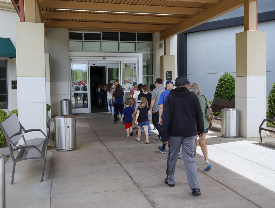 Photo - People enter Penn Square Mall during the re-opening of the mall after being closed because of the coronavirus pandemic, in Oklahoma City, Friday, May 1, 2020. [Nate Billings/The Oklahoman]