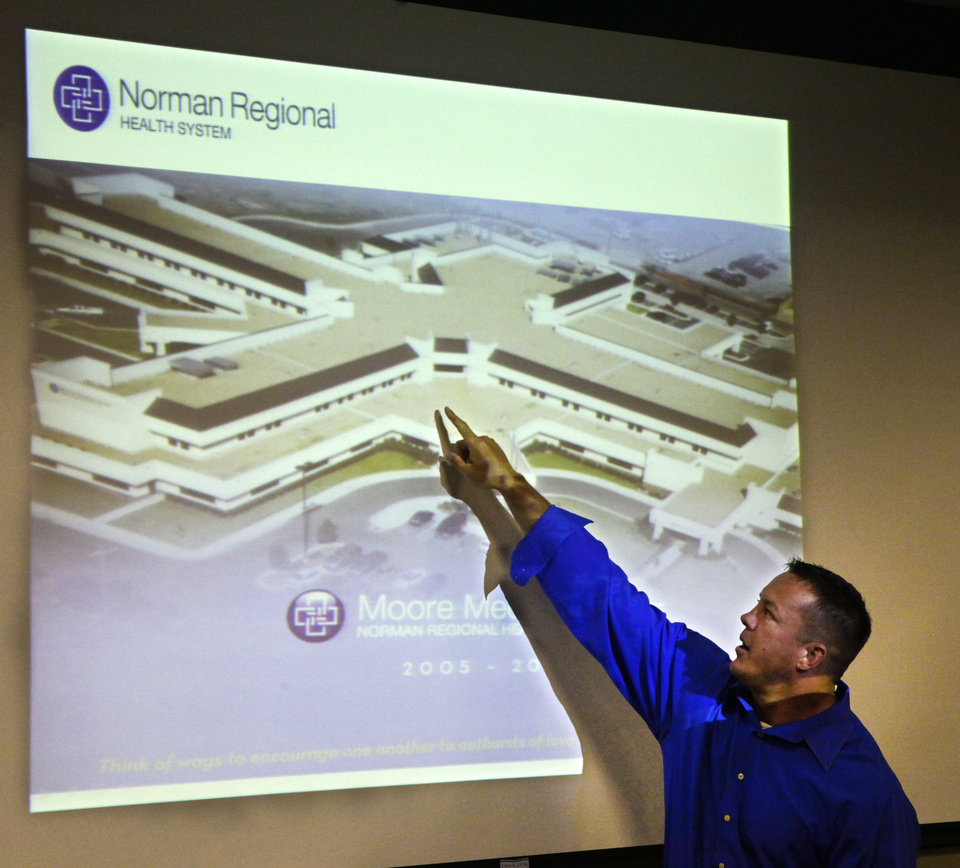 Photo - Shane Cohea, Moore Medical Center emergency preparedness director, points out areas of the Moore Hospital hit by the May 20 tornado during a meeting with local hospital representatives at Integris Cancer Institute on Tuesday.  David McDaniel - The Oklahoman