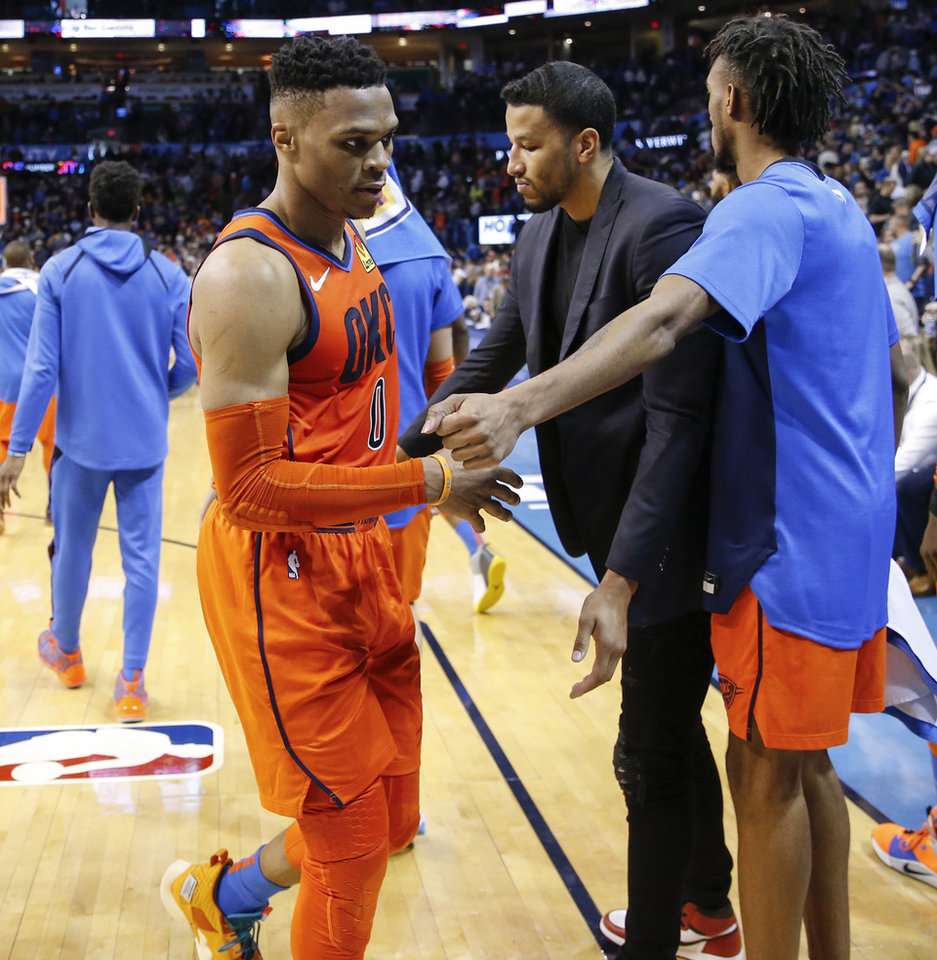 Photo - Oklahoma City's Russell Westbrook (0) leaves the court next to Terrance Ferguson (23), right, and Andre Roberson (21) after an NBA basketball game between the Dallas Mavericks and the Oklahoma City Thunder at Chesapeake Energy Arena in Oklahoma City, Sunday, March 31, 2019. Dallas won 106-103. Photo by Nate Billings, The Oklahoman