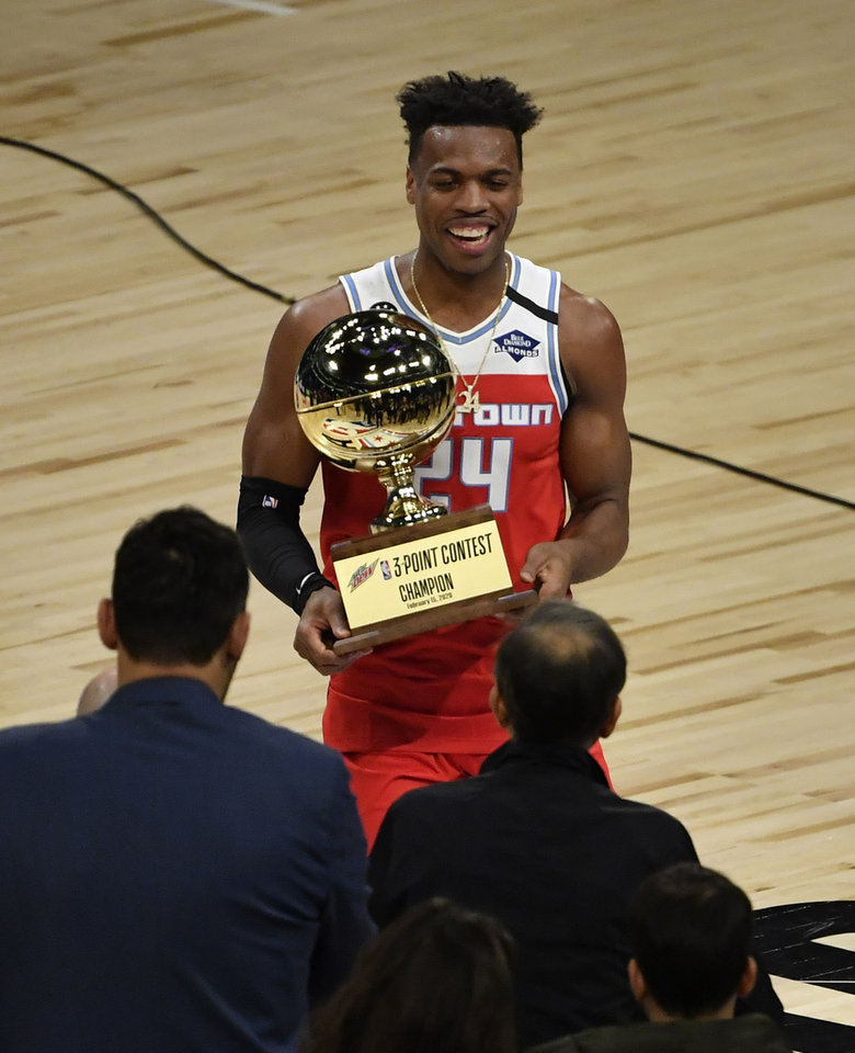 Photo - Feb 15, 2020; Chicago, Illinois, USA; Sacramento Kings player Buddy Hield celebrates with the trophy after winning the three point contest during NBA All Star Saturday Night at United Center. Mandatory Credit: Quinn Harris-USA TODAY Sports