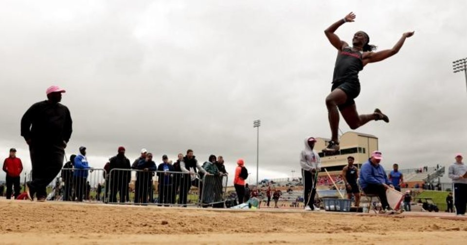 Photo -  Westmoore´s Anthony Riley participates in the long jump at the State Class 5A-6A track meet on May 11, 2019 in Moore, Okla.  [Steve Sisney/For The Oklahoman]