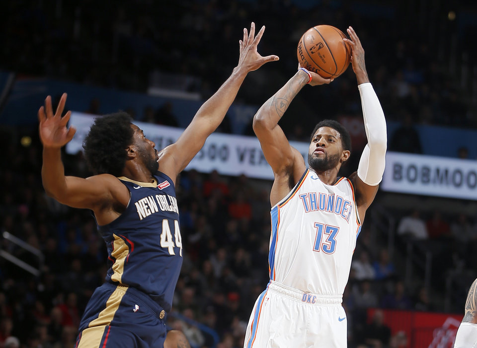 Photo - Oklahoma City's Paul George (13) shoots over New Orleans' Solomon Hill (44) during an NBA basketball game between the Oklahoma City Thunder and the New Orleans Pelicans at Chesapeake Energy Arena in Oklahoma City, Thursday, Jan. 24, 2019. Photo by Bryan Terry, The Oklahoman