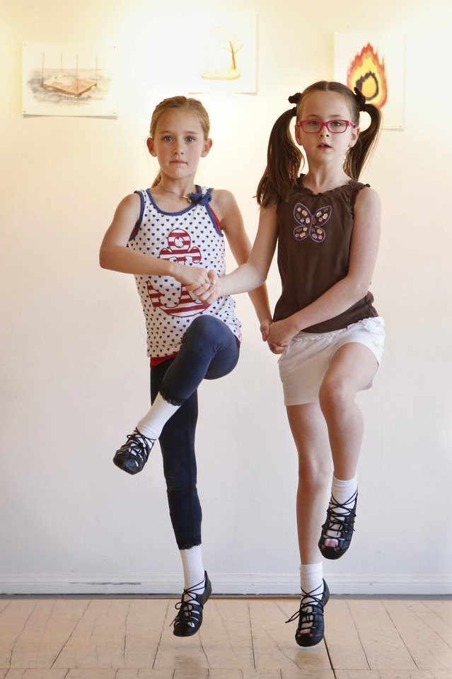 Photo - Niya Murray and Melanie Everson dance as children take an Irish Dancing class at Sonder Music, Dance & Arts on Friday, April 12, 2013 in Norman, Okla.  Photo by Steve Sisney, The Oklahoman