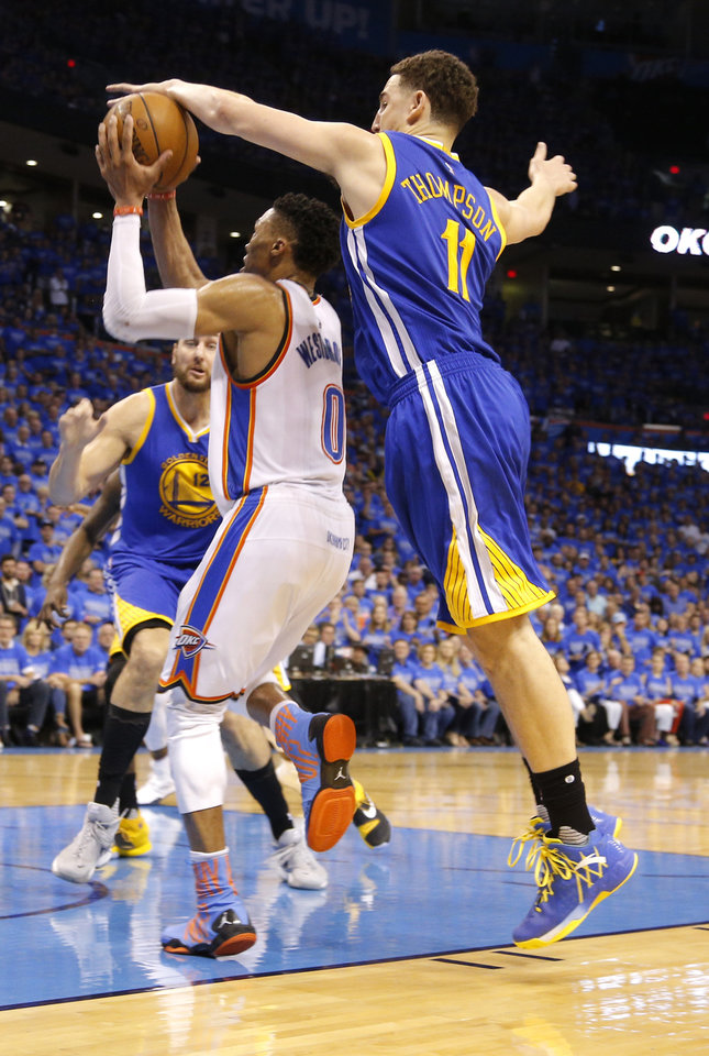 Photo - Oklahoma City's Russell Westbrook (0) is defended by Golden State's Klay Thompson (11) during Game 6 of the Western Conference finals in the NBA playoffs between the Oklahoma City Thunder and the Golden State Warriors at Chesapeake Energy Arena in Oklahoma City, Saturday, May 28, 2016. Photo by Sarah Phipps, The Oklahoman