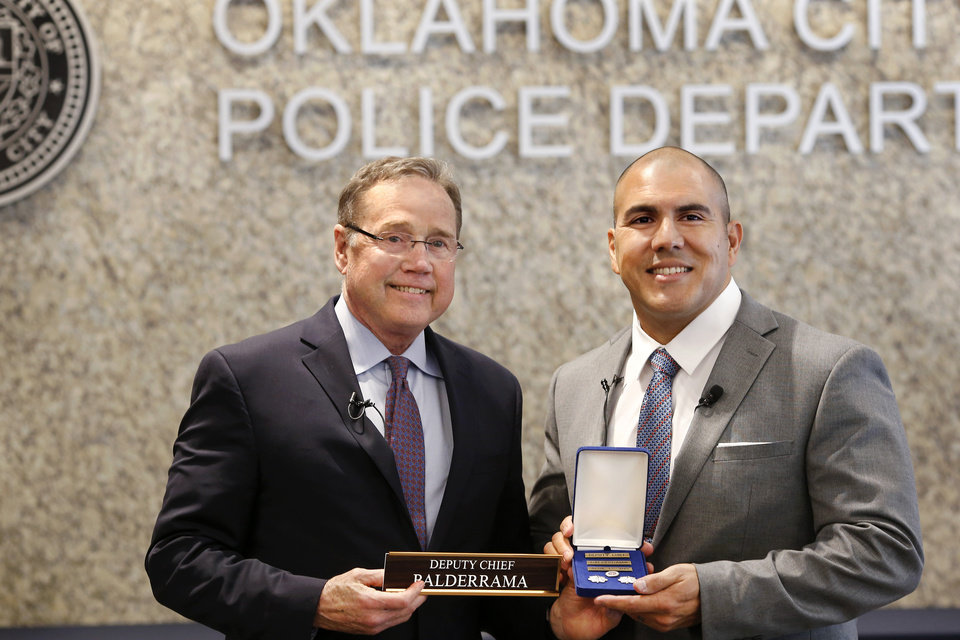 "Photo - During a ceremony at Oklahoma City Police headquarters Thursday morning, April 11, 2019, Major Paco Balderrama, right, made history when Chief Bill Citty formally promoted him to the rank of deputy chief, making him the first Hispanic to earn that rank in the department's history. Balderrama is a 20-year veteran of the department and has held various assignments during his time with OCPD. In 2000, Balderrama received the ""Rookie of the Year"" award after his first full year as a police officer. He has lived in Oklahoma City since 1993 and graduated from U.S. Grant High School in 1995. Photo by Jim Beckel, The Oklahoman."