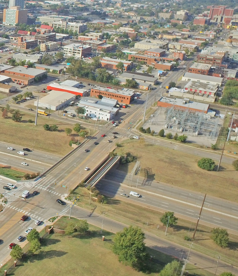 Photo -  The 10th Street bridge over Interstate 235 has one narrow unprotected sidewalk on the south side of the span. [Photo provided]