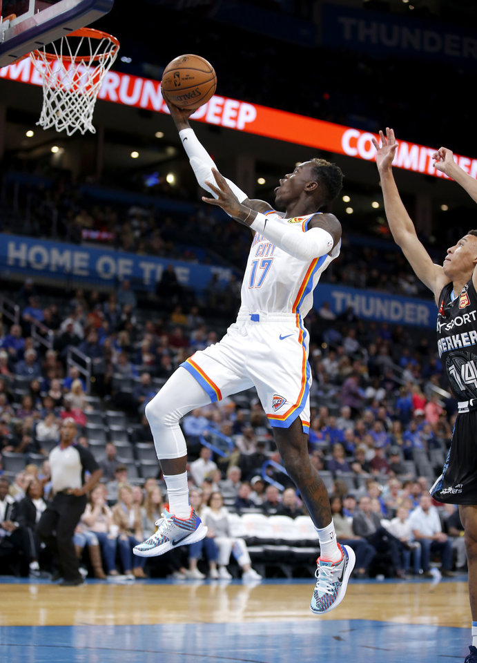 Photo - Oklahoma City's Dennis Schroder (17) goes up for a lay up as New Zealand Breakers' R.J. Hampton (14) defends during the NBA preseason game between the Oklahoma City Thunder and the New Zealand Breakers at the Chesapeake Energy , Thursday, Oct. 10, 2019. [Sarah Phipps/The Oklahoman]