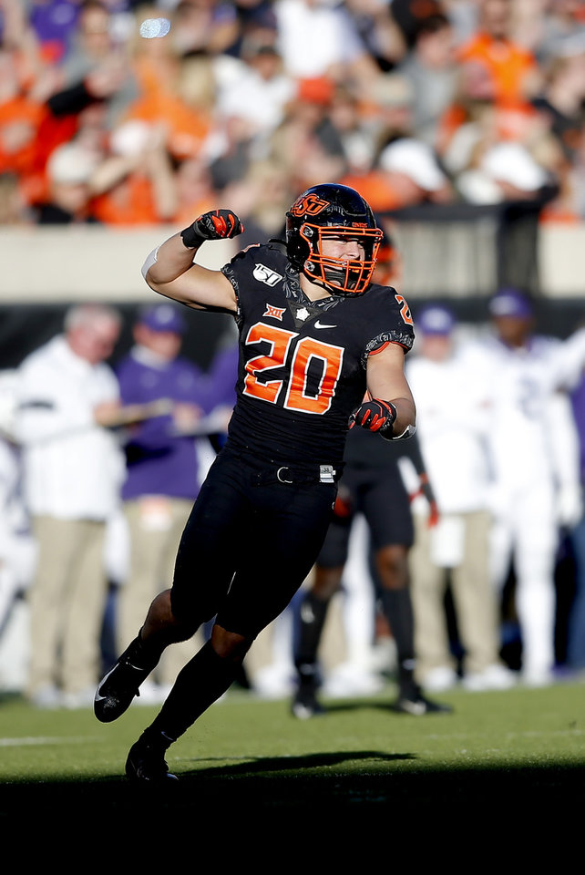 Photo - Oklahoma State's Malcolm Rodriguez (20)  celebrates a play in the third quarter during the college football game between the Oklahoma State University Cowboys and the TCU Horned Frogs at Boone Pickens Stadium in Stillwater, Okla.,  Saturday, Nov. 2, 2019. OSU won 34-27. [Sarah Phipps/The Oklahoman]
