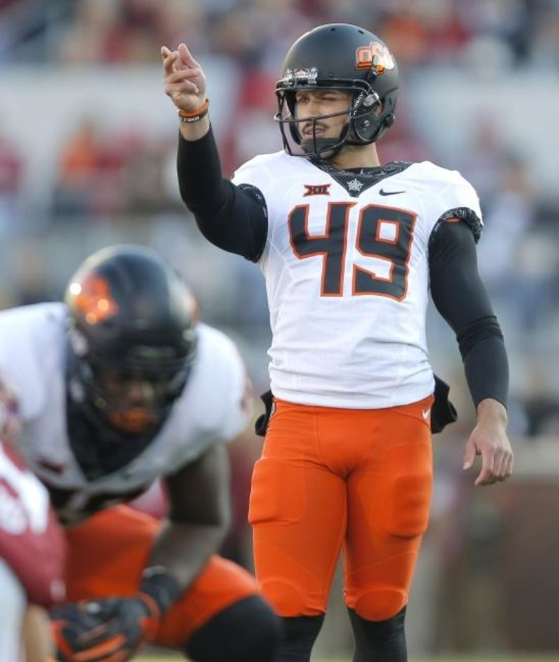 Photo -  Oklahoma State's Matt Ammendola prepares for a kick during a game last November against Oklahoma. Ammendola has become one of the most reliable kickers in OSU history. [Bryan Terry/The Oklahoman]