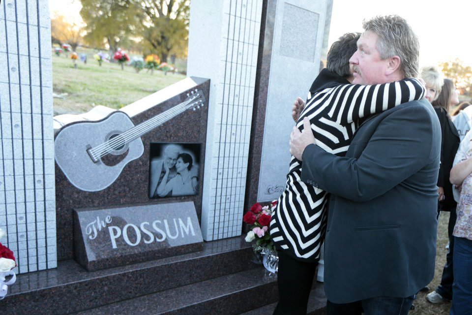 Photo - Nancy Jones, the widow of country music star George Jones, hugs singer Joe Diffie, right, at the memorial to the late singer dedicated on Monday, Nov. 18, 2013, in Nashville, Tenn. (AP Photo/Mark Humphrey)