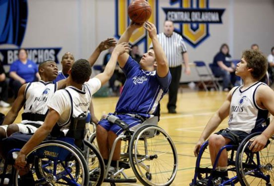 Photo -  Blaze's Adam Saldana shoots during the National Wheelchair Basketball Association's 2010 Southwest Conference, Saturday, Feb. 27, 2010, at the University of Central Oklahoma Wellness Center, in Edmond, Okla.  Photo by Sarah Phipps, The Oklahoman