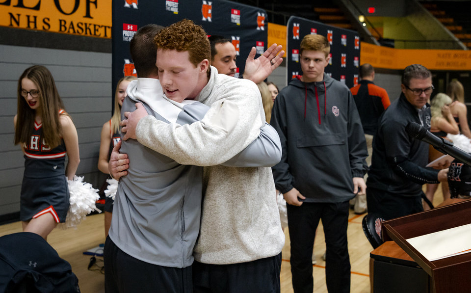 Photo - Oklahoma State University signee Cole Thompson, right, celebrates with his coaches during a national signing day ceremony for football at Norman High School in Norman Okla. on Wednesday, Dec. 18, 2019.   [Chris Landsberger/The Oklahoman]