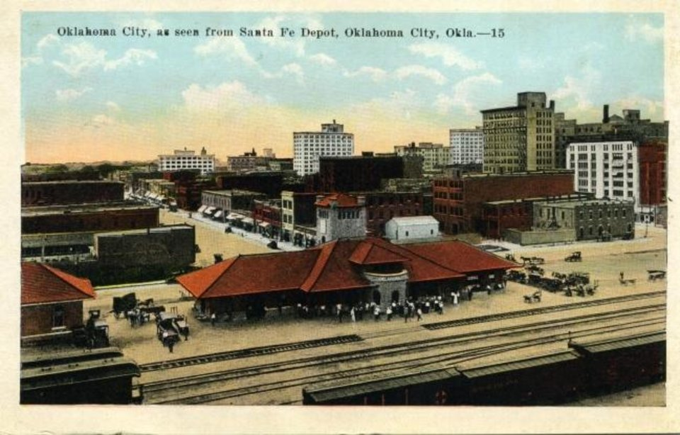 Photo -  The Atchison, Topeka and Santa Fe Railway station in Oklahoma City is pictured on this postcard produced in 1915. [OKLAHOMA HISTORICAL SOCIETY]