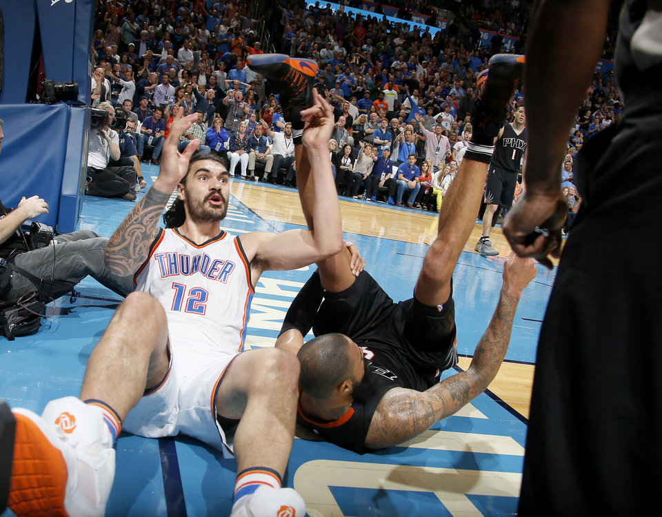 Photo - Oklahoma City's Steven Adams (12) looks towards an official after going fot the ball beside Phoenix's Tyson Chandler (4) during an NBA basketball game between the Oklahoma City Thunder and the Phoenix Suns at Chesapeake Energy Arena in Oklahoma City, Friday, Oct. 28, 2016. Photo by Bryan Terry, The Oklahoman