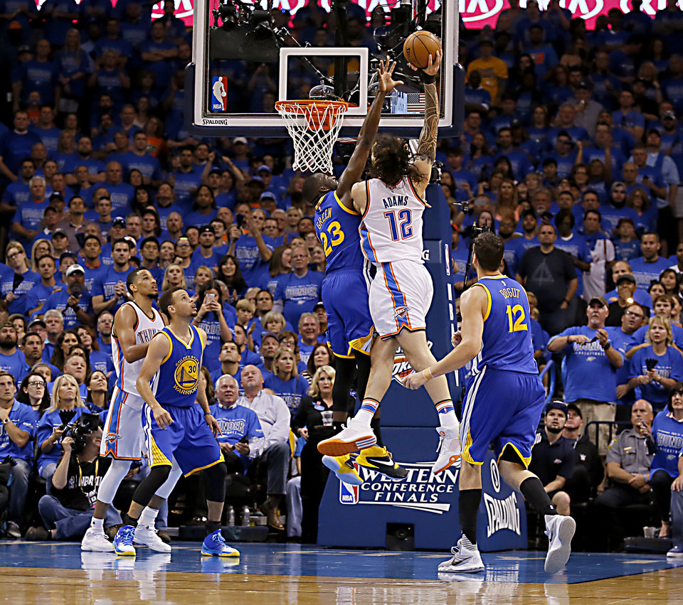 Photo - Oklahoma City's Steven Adams (12) dunks over Golden State's Draymond Green (23) during Game 6 of the Western Conference finals in the NBA playoffs between the Oklahoma City Thunder and the Golden State Warriors at Chesapeake Energy Arena in Oklahoma City, Saturday, May 28, 2016. Photo by Sarah Phipps, The Oklahoman
