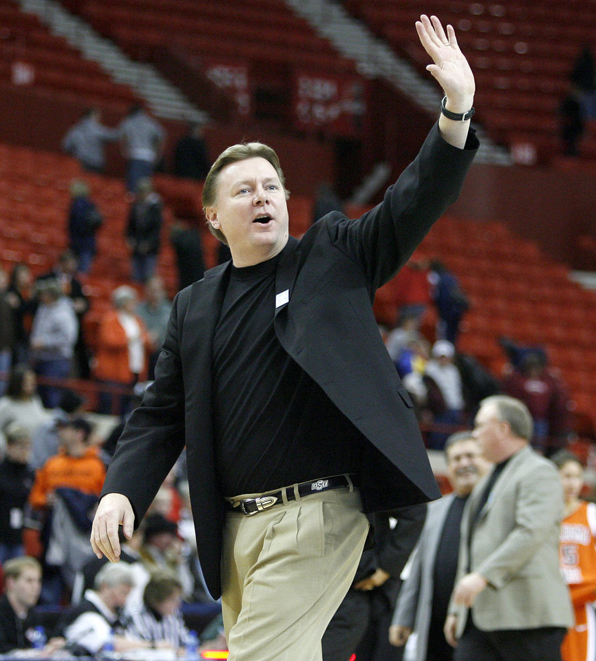 Photo - OSU coach Kurt Budke waves to the crowd after OSU's win in the Big 12 Women's Championships game between Oklahoma State University and Texas Tech at the Cox Convention Center in Oklahoma City, Thursday, March 12, 2009.  PHOTO BY BRYAN TERRY, THE OKLAHOMAN