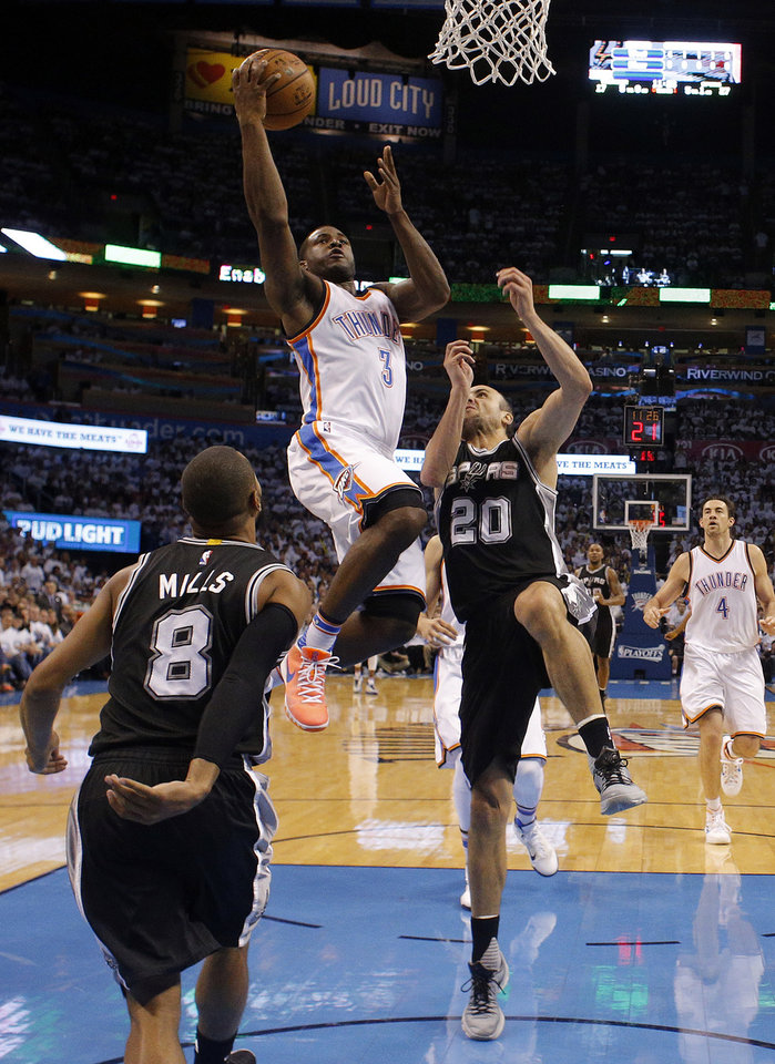 Photo - Oklahoma City's Dion Waiters (3) shoots a lay up as San Antonio's Patty Mills (8) and Manu Ginobili (20) defend during Game 4 of the Western Conference semifinals between the Oklahoma City Thunder and the San Antonio Spurs in the NBA playoffs at Chesapeake Energy Arena in Oklahoma City, Sunday, May 8, 2016. Photo by Sarah Phipps, The Oklahoman