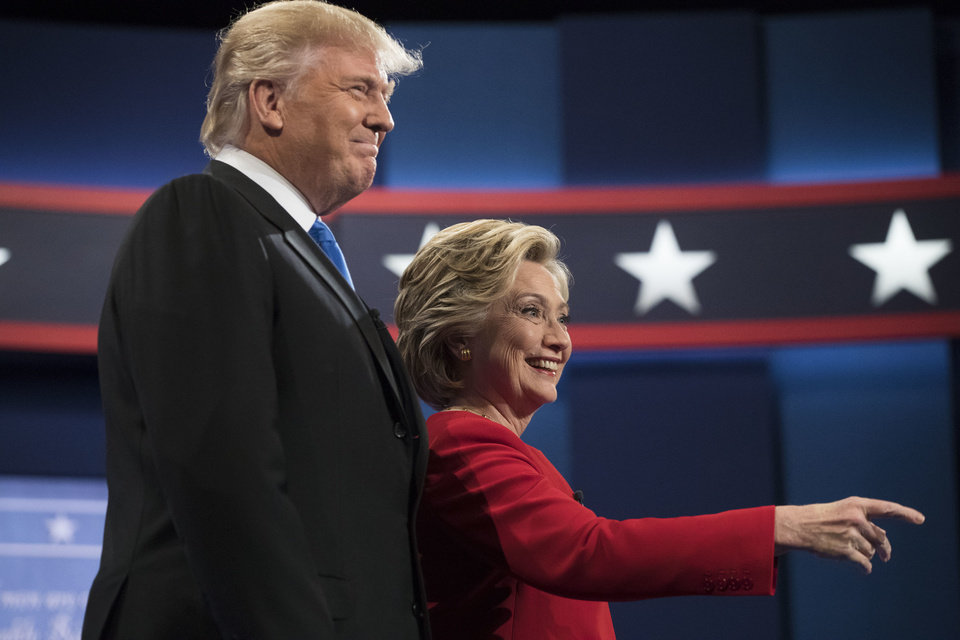 Photo - Democratic presidential candidate Hillary Clinton and Republican presidential candidate Donald Trump meet during the first presidential debate at Hofstra University in Hempstead, N.Y., Monday, Sept. 26, 2016. (AP Photo/Matt Rourke)