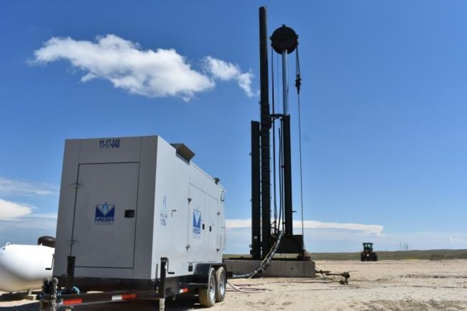 Photo -  A Mesa Natural Gas Solutions generator powers production equipment at a well in the Powder River Basin in Wyoming.