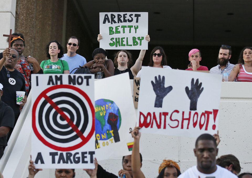 "Photo - People hold signs at a ""protest for justice"" over Friday's shooting death of Terence Crutcher, sponsored by We the People Oklahoma, in Tulsa, Okla., Tuesday, Sept. 20, 2016. (AP Photo/Sue Ogrocki)"