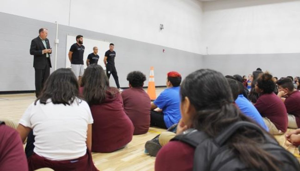 Photo -  Wheeler Middle School students listen as Energy FC manager Jason Hawkins and players Nicolas Taravel, Cody Laurendi and Rafael Garcia encourage them to dream big and value the importance of schoolwork and teamwork. [PHOTO PROVIDED]