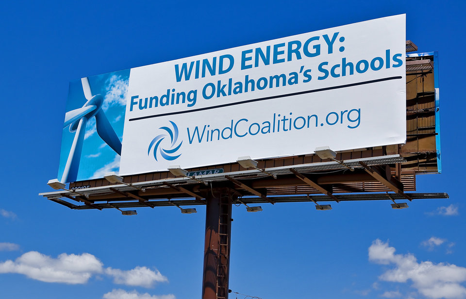 Photo -  Billboards along I-235 from lobbying groups trying to raise awareness for a tax incentives for wind energy in Oklahoma City, Okla. on Thursday, April 21, 2016. Photo by Chris Landsberger, The Oklahoman