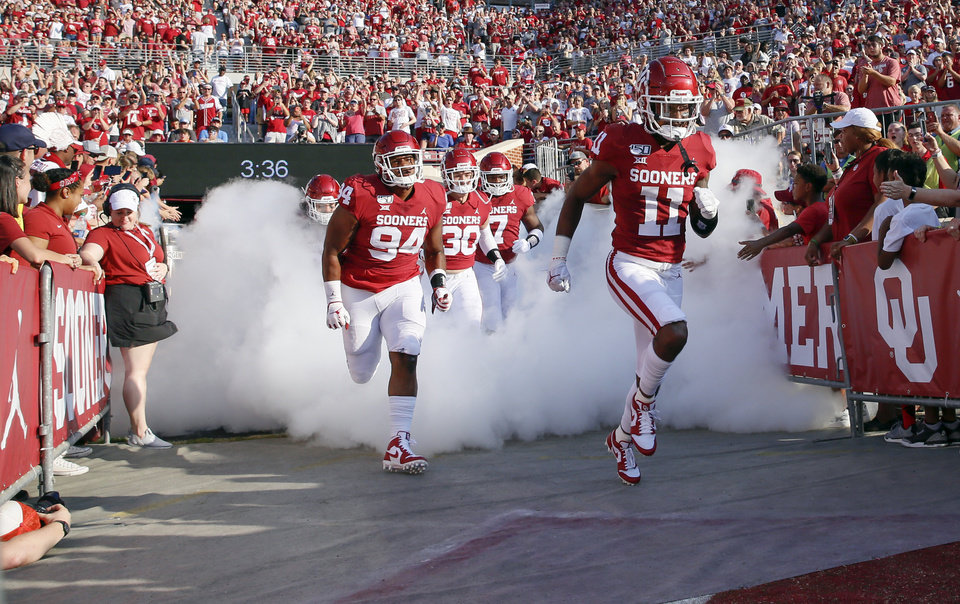 Photo - The Sooners take the field before a college football game between the Oklahoma Sooners (OU) and South Dakota Coyotes at Gaylord Family - Oklahoma Memorial Stadium in Norman, Okla., Saturday, Sept. 7, 2019. [Nate Billings/The Oklahoman]