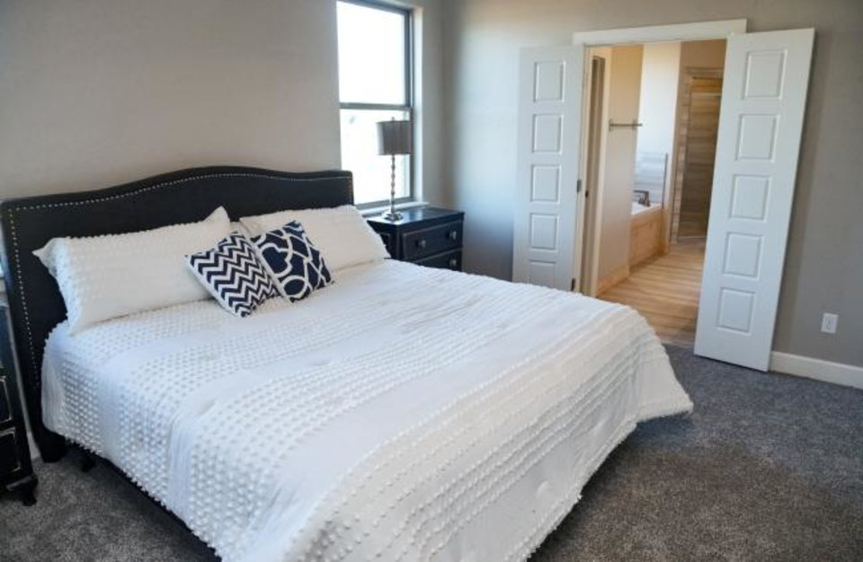 Photo -  Master bedroom of Denise Patterson Custom Homes' entry in the Parade of Homes at 6308 NW 178 Terrace. The parade will be Sept. 14-22. [CHRIS LANDSBERGER/THE OKLAHOMAN]