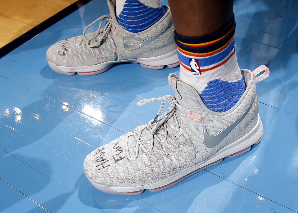 "Photo - The phrase ""Have Fun"" can be seen on Kevin Durant's (35) shoes during Game 3 of the Western Conference finals in the NBA playoffs between the Oklahoma City Thunder and the Golden State Warriors at Chesapeake Energy Arena in Oklahoma City, Sunday, May 22, 2016. Oklahoma City won 133-105. Photo by Bryan Terry, The Oklahoman"