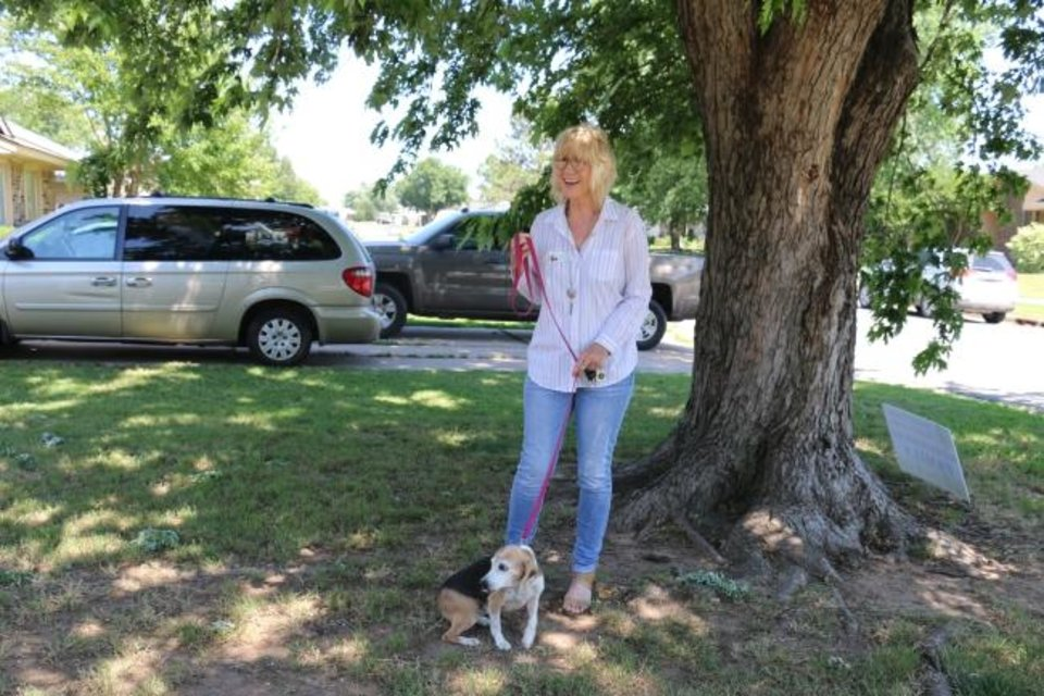 Photo -  Debra Penrod, a real estate agent with Metro Brokers of Oklahoma, and Ramona the Realtor Dog. [OHFA PHOTO]